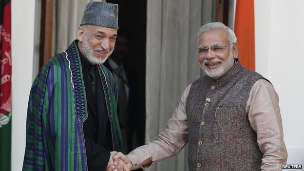 PM Narendra Modi with Afghan President Hamid Karzai before the start of their meeting in Delhi May 27, 2014.