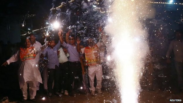 BJP supporters light fireworks to celebrate Narendra Modi's swearing in outside the BJP headquarters in Delhi May 26, 2014