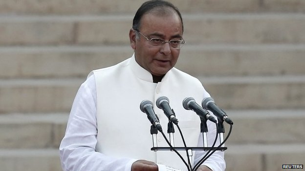 Arun Jaitley takes the oath as a cabinet minister at the presidential palace in New Delhi May 26, 2014.