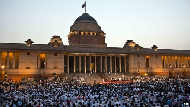 Modi's council of ministers take the oath of office in the forecourt during the swearing-in ceremony at the Presidential Palace in New Delhi on May 26, 2014.
