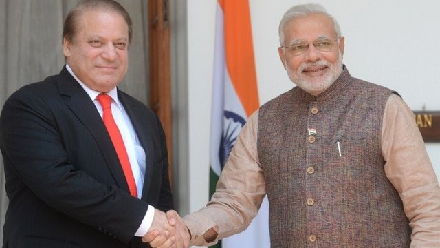 "India""s newly sworn-in Prime Minister Narendra Modi (R) shakes hands with Pakistani Prime Minister Nawaz Sharif during a meeting in New Delhi on May 27, 2014."