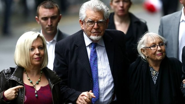 Rolf Harris arrives with his wife Alwen Hughes (right) and his daughter Bindi at Southwark Crown Court in London, 27 May