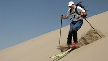 A man skiing on sand
