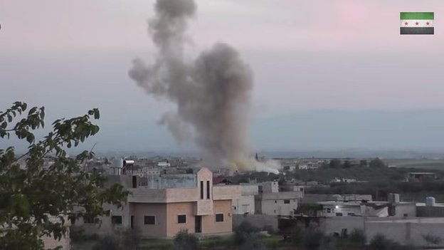 Screenshot from a video posted online on 11 April 2014 showing substantial yellow coloration at base of a cloud over Kafr Zaita, Syria, following a barrel-bomb explosion