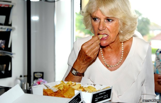 Camilla, Duchess of Cornwall samples haddock and chips in Bridlington in July 2013