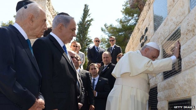 President Shimon Peres and Prime Minister Benjamin Netanyahu accompany Pope Francis as he visits a memorial commemorating Israelis killed by Palestinian militants, on Mount Herzl