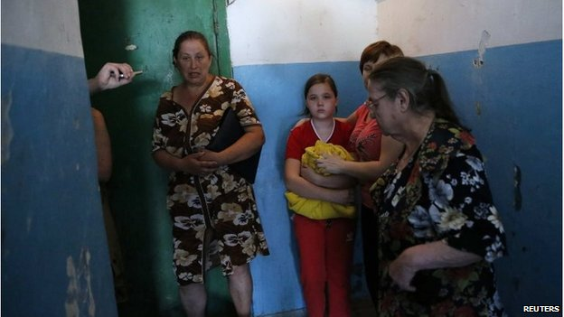 Family sheltering from fighting in a building near Donetsk airport (26 May 2014)