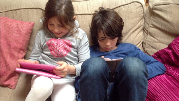 Lily and Archie using tablets
