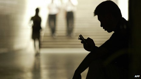 A man using mobile phone in China