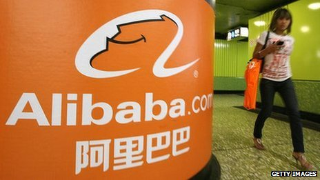 Alibaba.com logo and woman walking