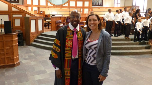 Reverend Raphael Warnock, the senior pastor at the Ebenezer Baptist Church in Atlanta, with Murphy Cobbing