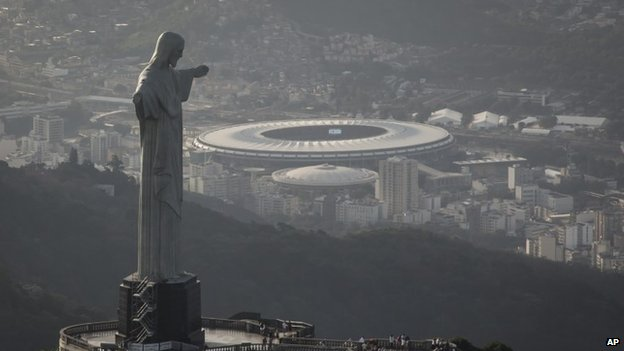 An aerial view shot of the Maracana stadium behind the Christ the Redeemer statue in Rio de Janeiro