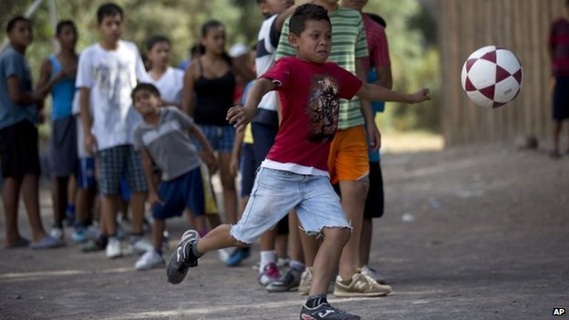 A child kicks a football ball during practice in Tegucigalpa, Honduras, on 7 March, 2014