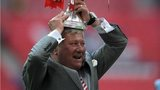 Rotherham United chairman Tony Stewart celebrates with the trophy on the pitch after the final whistle