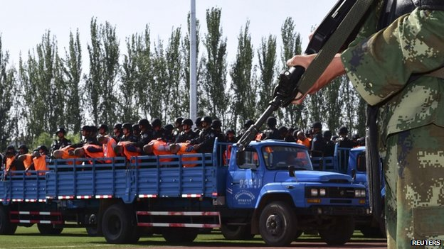 Criminals and suspects are transported to a stadium for a mass sentencing rally in Yili, Xinjiang Uighur Autonomous Region, 27 May 2014