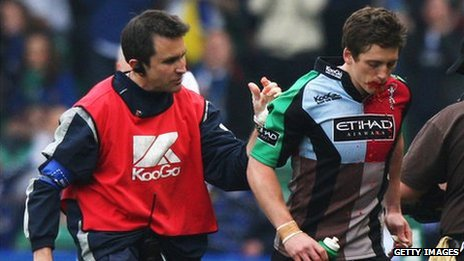 Tom Williams of Harlequins walks off  the pitch as blood pours from his mouth during the Heineken Cup Quarter Final v Leinster in 2009