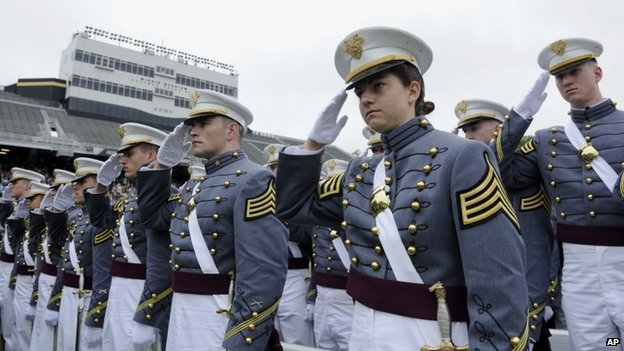 Members of the US Military Academy at West Point Class of 2014, in West Point, NY, salute as President Barack Obama arrives, 28 May 2014