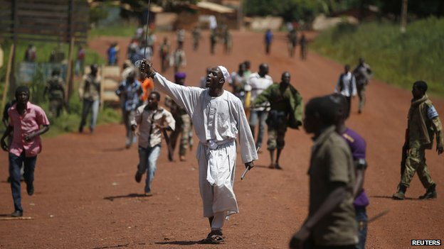 A man brandishes a sword during clashes between French soldiers and Seleka fighters in Bambari May 24