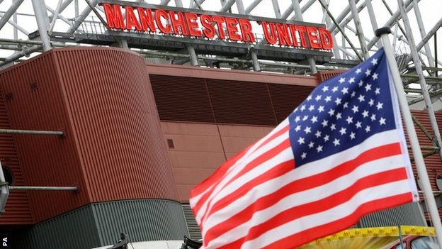 A US flag outside Old Trafford