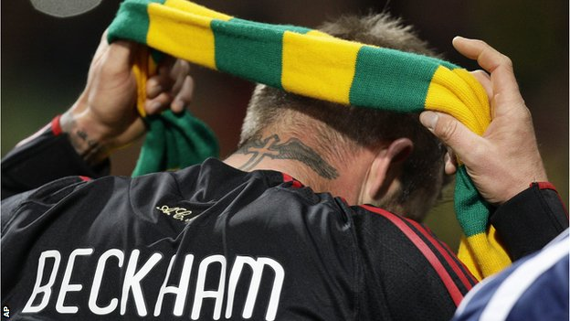 Former Manchester United player David Beckham donned a green and yellow scarf in support of the anti-Glazer protest when he returned to the club with AC Milan for a Champions League tie in 2010