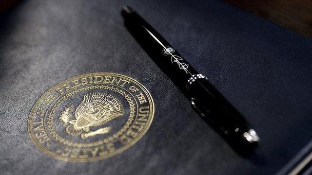 A pen used by U.S. President Barack Obama lies on an executive order prior to signing in the Eisenhower Executive Office Building January 21, 2009 in Washington, DC