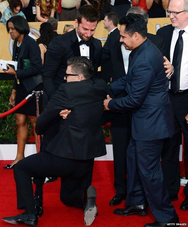 Vitalii Sediuk with Bradley Cooper at the SAG Awards