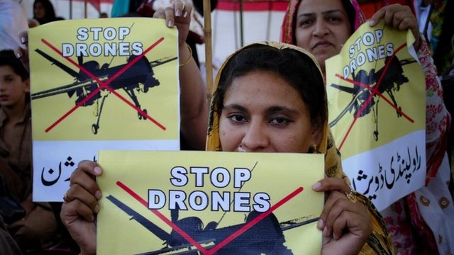 Pakistan women take part in a rally against the U.S. drone strikes in Pakistani tribal areas in Peshawar, Pakistan