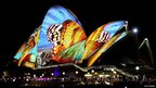 Pictures of butterflies projected onto the side of the Sydney Opera House