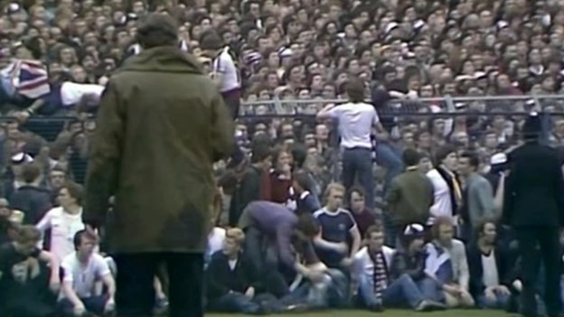 Tottenham Hotspur fans spilled on to the perimeter track at the Leppings Lane end of the ground