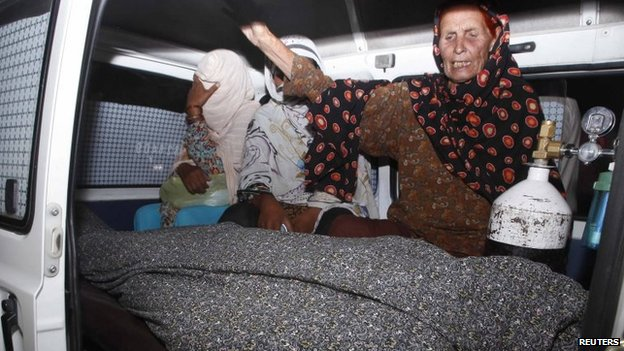 Women mourn over the body of their relative, Farzana Parveen, who was killed by family members, in an ambulance outside of a morgue in Lahore May 27