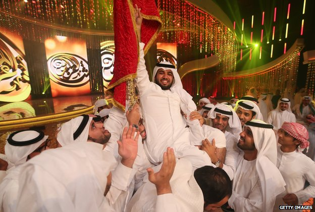 Saif al-Mansuri being held aloft by other contestants on Million's Poet
