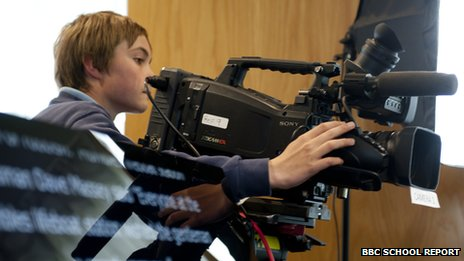School Reporter using video camera