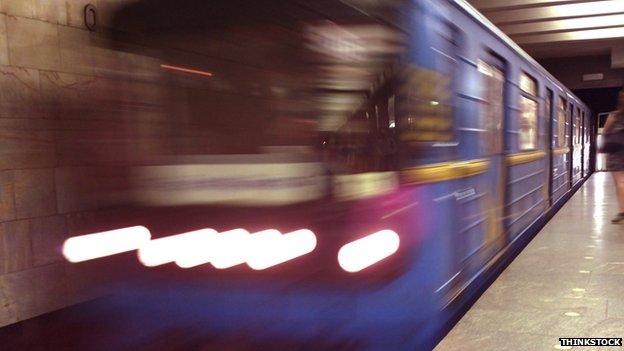 Subway train pulling into station