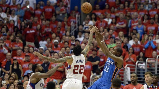 LA Clippers players face Oklahoma City Thunder. Photo: May 2014
