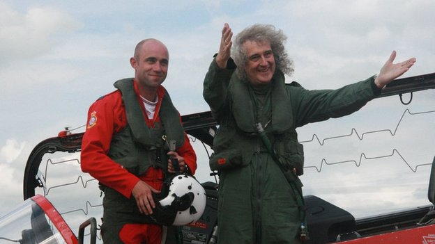 Flight Lieutenant Ben Plank with Queen guitarist Brian May