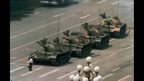 A man stands alone to block a line of tanks heading east on Beijing's Chang'an Avenue on 5 June 1989