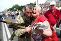 A woman embraces a pro-Russian separatist during a rally in the Ukrainian city of Donetsk