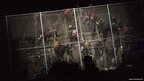 Sub-Saharan migrants scale a fence that divides Morocco and the Spanish enclave of Melilla, early in the morning