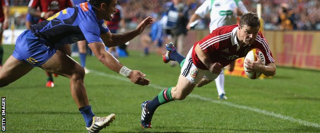 Brian O'Driscoll dives over for the Lions during their 2013 tour