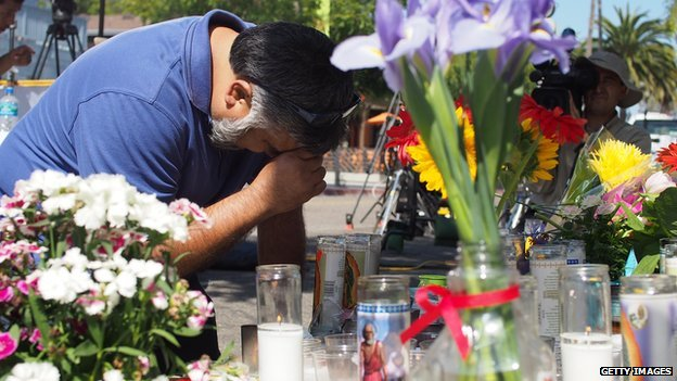 A man mourns in front of a makeshift memorial in Isla Vista, California.
