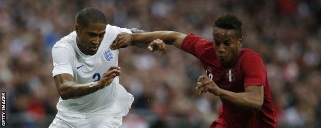 Glen Johnson competes for the ball
