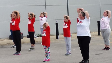 A group taking part in zumba