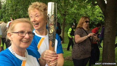 Bearers including Ann Brightwell, nee Packer, (r) holding the baton