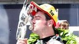 A delighted Michael Dunlop kisses the trophy after his Superbike victory
