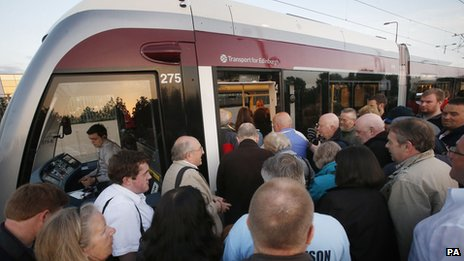 People queuing to get on Edinburgh tram