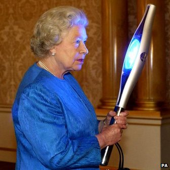 Queen Elizabeth II holds the hi-tech baton, designed to relay the Queens opening message to the Golden Jubilee Commonwealth Games in Manchester 2002