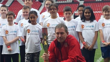 Bryan Robson with children who attended the event