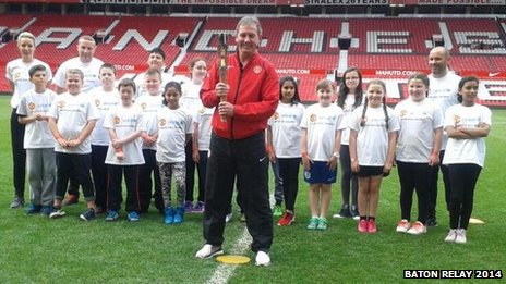 Bryan Robson with schoolchildren who attended the Queen's Baton relay