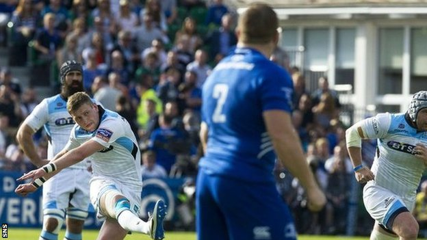 Finn Russell scores with the boot to give Glasgow an early lead