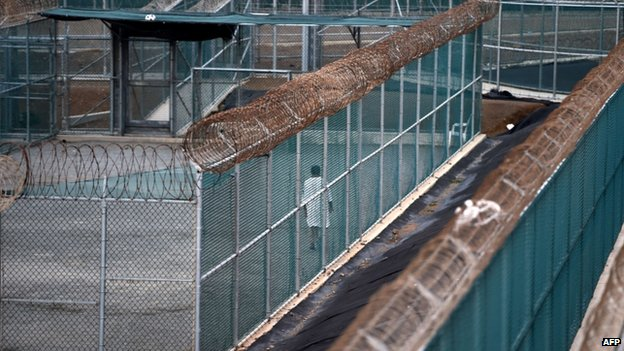 Unidentified detainee walks in the exercise yard at Guantanamo (8 April 2014)